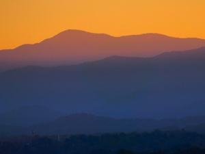 Photo of a sunset over the Blue Ridge Mountains of Asheville, NC.